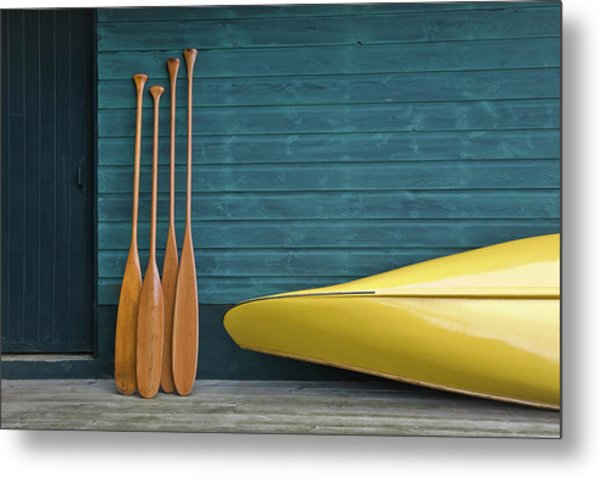 Yellow Canoe And Paddles On Dock Metal Print by Mary Ellen Mcquay