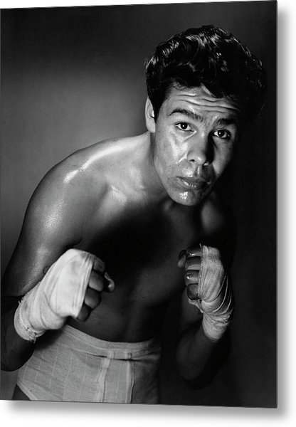 Young Adult Man In A Fighting Stance Metal Print by Superstock