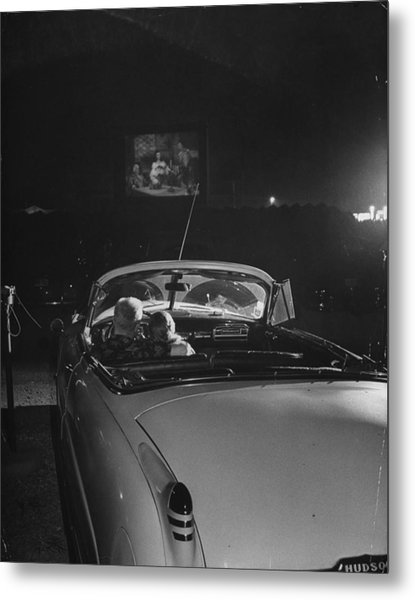 Young Couple Cuddling At The Drive In Metal Print