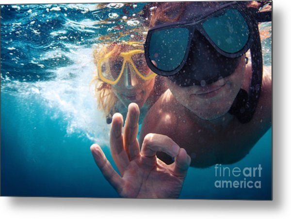 Young Couple Having Fun Underwater And Metal Print