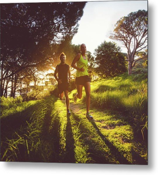 Young Couple Jogging Metal Print