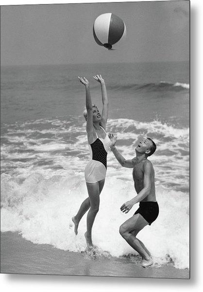 Young Couple Playing With Beach Ball At Metal Print