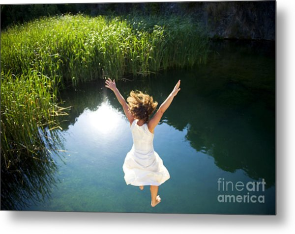 Young Woman In White Dress Jumping Into Metal Print