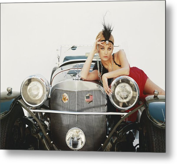 Young Woman Lying On Vintage Car Metal Print by Tom Kelley Archive