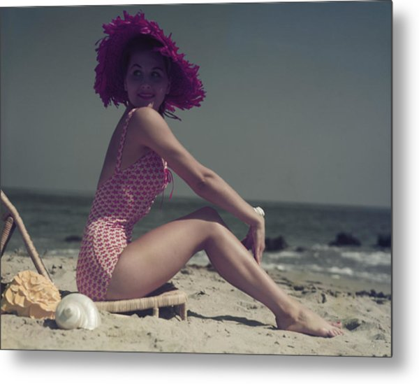 Young Woman Sitting On Lounge Chair On Metal Print