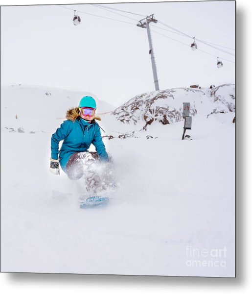 Young Woman Snowboarder In Motion On Metal Print