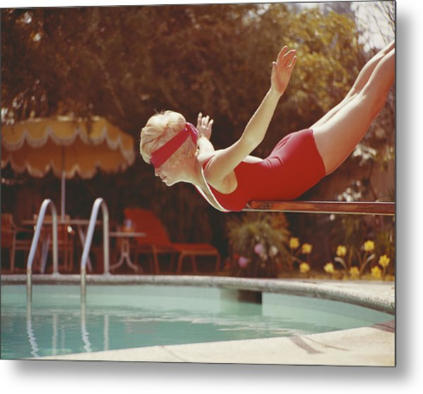 Young Woman With Blindfold Balancing On Metal Print