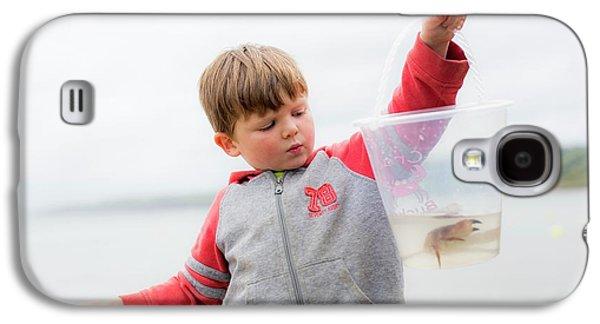 Boy Holding Crab Galaxy S4 Case by Samuel Ashfield