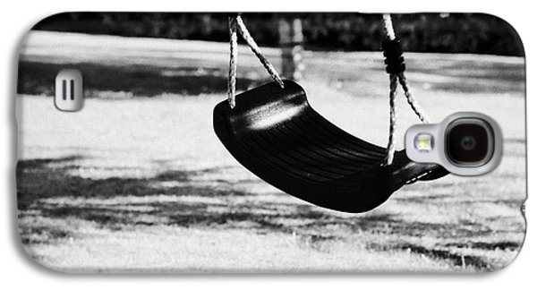 Empty Plastic Swing Swinging In A Garden In The Evening Galaxy S4 Case
