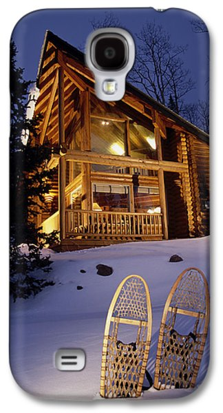 Lighted Cabin With Snowshoes In Front Galaxy S4 Case by Michael DeYoung