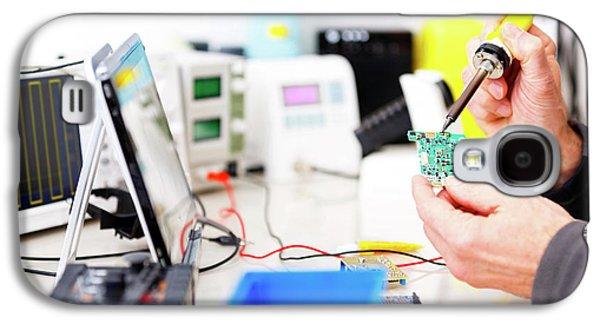 Person Repairing Electronic Circuit Board Galaxy S4 Case by Wladimir Bulgar