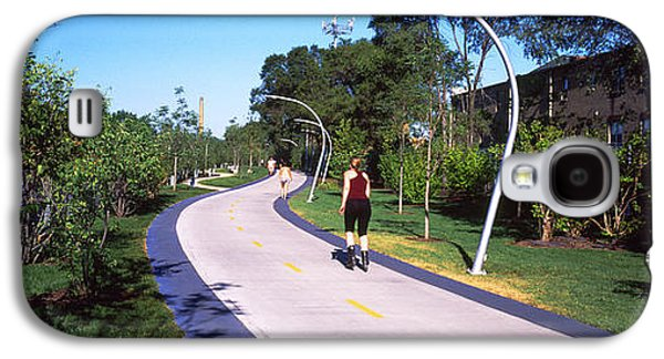 Rear View Of Woman Jogging In A Park Galaxy S4 Case by Panoramic Images