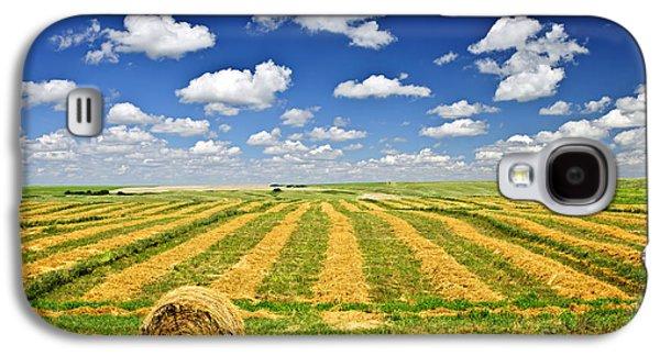 Wheat Farm Field And Hay Bales At Harvest In Saskatchewan Galaxy S4 Case by Elena Elisseeva