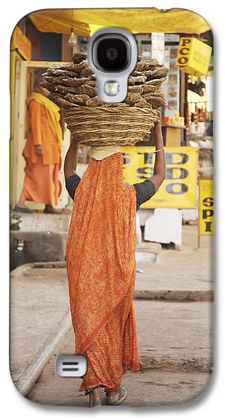 Woman Carrying Cow Dung In Basket On Galaxy S4 Case by Paul Miles