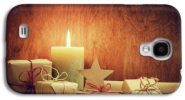 Chistmas Presents, Gifts With A Candle Glowing On Wooden Wall Background. Galaxy S4 Case