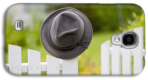 A Hat Hanging On The Post Of A White Galaxy S4 Case by Lorna Rande