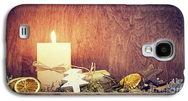Chistmas Decoration With Candle Glowing On Wooden Wall Background Galaxy S4 Case