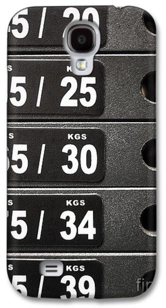 Stack Of Weight Plates  On Gym Equipment Galaxy S4 Case by Paul Velgos