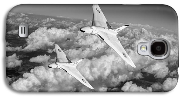 Galaxy S4 Case featuring the photograph Two Avro Vulcan B1 Nuclear Bombers Bw Version by Gary Eason