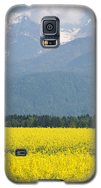 rapeseed field in Brnik with Kamnik Alps in the background Galaxy S5 Case by Ian Middleton