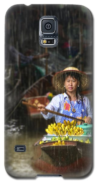 Galaxy S5 Case featuring the photograph Banana Vendor In The Rain by Rob Tullis