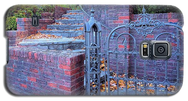 Galaxy S5 Case featuring the photograph Brick Wall With Wrought Iron Gate by Janette Boyd