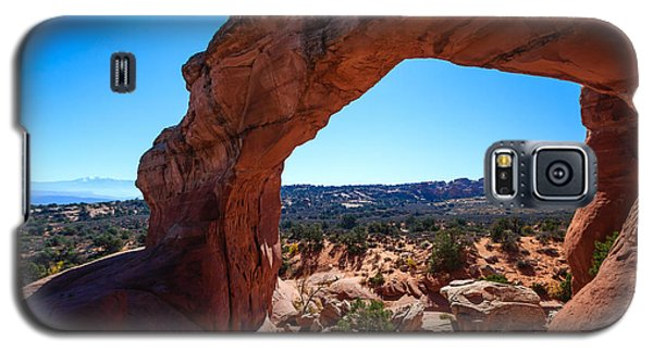 Galaxy S5 Case featuring the photograph Broken Arch Under Blue Sky by Peta Thames