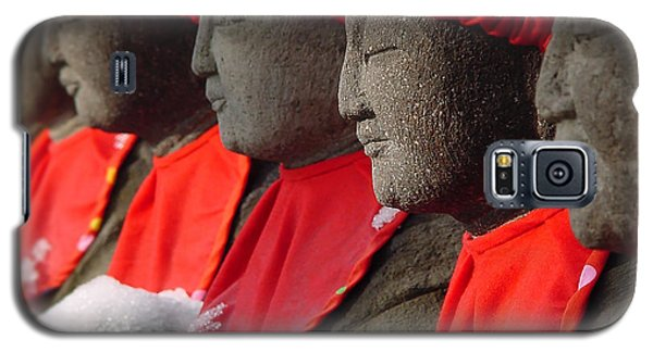 Galaxy S5 Case featuring the photograph Buddhist Statues In Snow by Larry Knipfing
