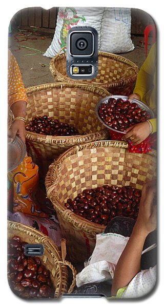 Galaxy S5 Case featuring the photograph Burmese Ladies Sorting Water Chestnuts Zay Cho Street Market 29th Street Mandalay Burma by Ralph A  Ledergerber-Photography
