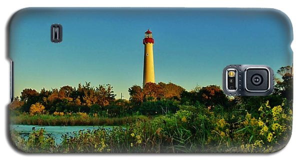 Galaxy S5 Case featuring the photograph Cape May Lighthouse Above The Flowers by Ed Sweeney