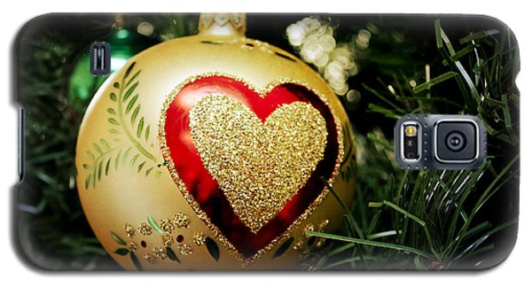 Galaxy S5 Case featuring the photograph Christmas Gold Ball With Heart by Maria Janicki