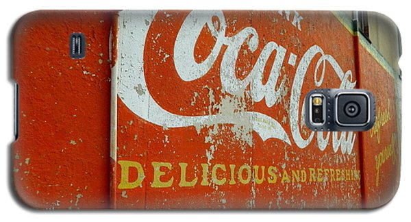 Galaxy S5 Case featuring the photograph Coca-cola On The Army Store Wall by Kathy Barney