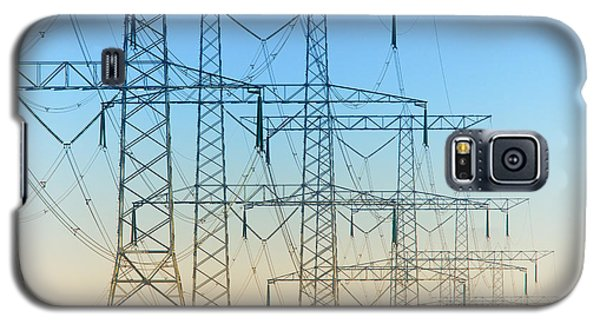 Galaxy S5 Case featuring the photograph Electricity Pylons Standing In A Row by Nick  Biemans
