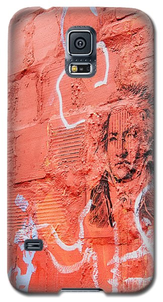 Galaxy S5 Case featuring the photograph Etched Man On A Red Brick Wall by Jim Lepard