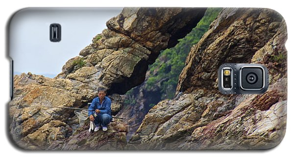 Galaxy S5 Case featuring the photograph Fisherman On Rocks  by Sarah Mullin