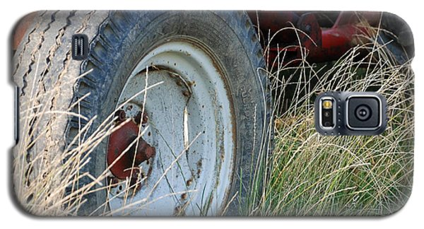 Galaxy S5 Case featuring the photograph Ford Tractor Tire by Jennifer Ancker