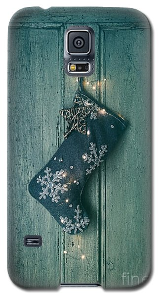 Galaxy S5 Case featuring the photograph Holiday Stocking With Lights Hanging On Old Door by Sandra Cunningham