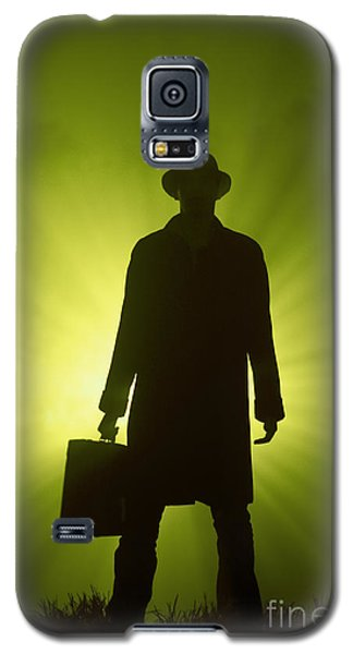 Galaxy S5 Case featuring the photograph Man With Case In Green Light by Lee Avison
