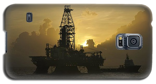 Galaxy S5 Case featuring the photograph Offshore Oil Rig With Sun And Clouds by Bradford Martin