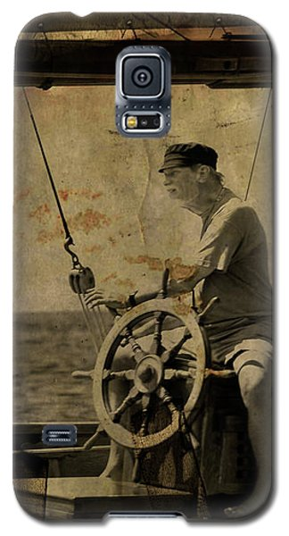Galaxy S5 Case featuring the photograph old sailor A vintage processed photo of a sailor sitted behind the rudder in Mediterranean sailing by Pedro Cardona