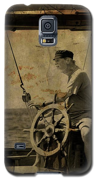 old sailor A vintage processed photo of a sailor sitted behind the rudder in Mediterranean sailing Galaxy S5 Case by Pedro Cardona