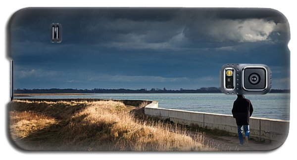 One Man Walking Alone By Sea Wall In Sunshine On Dramatic Stormy Galaxy S5 Case