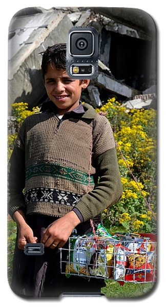 Galaxy S5 Case featuring the photograph Pakistani Boy In Front Of Hotel Ruins In Swat Valley by Imran Ahmed