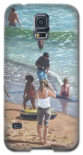 people on Bournemouth beach pulling dingys Galaxy S5 Case