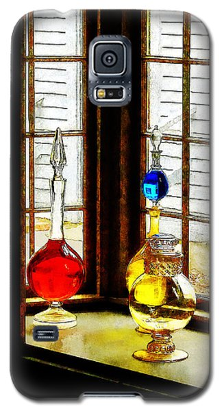 Galaxy S5 Case featuring the photograph Pharmacist - Colorful Bottles In Drug Store Window by Susan Savad