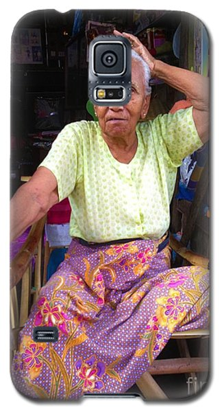 Galaxy S5 Case featuring the photograph Portrait Of Elderly Burmese Lady Sitting In Front Of Home 33rd Street Chanayethazan Mandalay Burma by Ralph A  Ledergerber-Photography