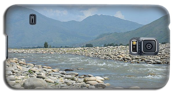 Galaxy S5 Case featuring the photograph Riverbank Water Rocks Mountains And A Horseman Swat Valley Pakistan by Imran Ahmed