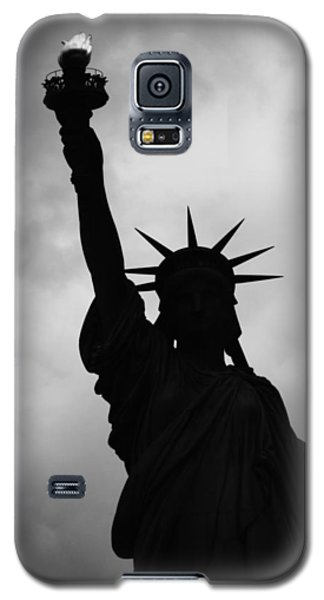 Galaxy S5 Case featuring the photograph Statue Of Liberty Silhouette by Dave Beckerman