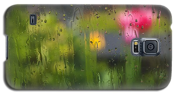 Galaxy S5 Case featuring the photograph Tulips Through The Rain by Maria Janicki