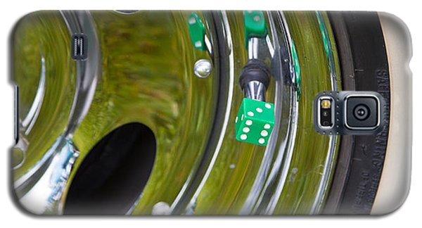 Galaxy S5 Case featuring the photograph White Wall Tyre Chrome Rim And Dice by Mick Flynn